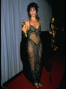 Cher holding Oscar for 'Moonstruck,' April 11, 1988.